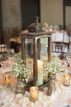 rustic wedding ideas--Rustic wedding centerpieces with baby breath and candle lanterns, fall weddings, country barn/ farm weddings, diy wedding decorations on a budget, wedding reception ideas Lantern Centerpiece Wedding, Wedding Lanterns, Rustic Wedding Centerpieces, Reception Decorations, Centerpiece Ideas, Rustic Weddings, Wedding Rustic, Reception Ideas, Antique Wedding Decorations