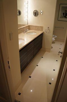 Mechanical #resurfacing of #limestone #flooring in high end residential #bathroom