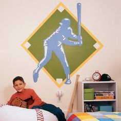 overhead projector and transparency draw then paint onto sports themed bedroom wall