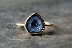 Just soooooooooo beautiful, like the night sky | Anatomi Kyla O'Connor's Madison, WI-based jewelry line, Anatomi, has the whole raw-gemstone thing on lock. Here, you can shop a variety of handpicked fossils, geodes, and other unique gems.  #refinery29 http://www.refinery29.com/best-etsy-jewelry#slide-19