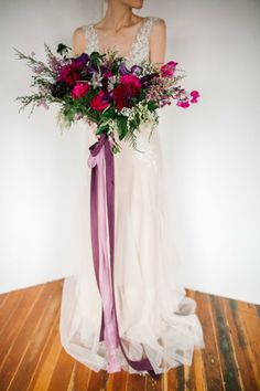 Love this asymmetrical red and purple bridal bouquet | Moody Springtime Wedding Inspiration via @Bellesbubbles, pics by Marie Claire Photography