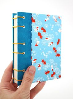 Handmade Coptic stitch journal with adorable tiny goldfish, perfect gift for a writer