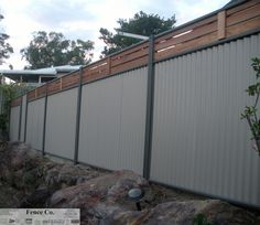 Hardwood posts and colorbond corrugated iron fence for Blechwand pool