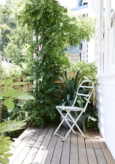 Our front deck with a very dear vintage chair salvaged from my days set dressing in the film industry, with an especially lush front garden ...