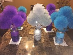 Disney Frozen centerpiece! Glitter mason jars with tulle pom pom wands... How to make jars and pom poms on my diy board!