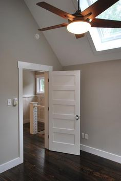 Gorgeous five panel doors and ceiling fan