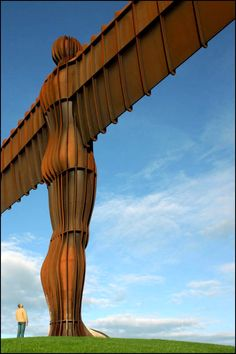 """Stand beside the Angel of the North"" in Newcastle upon Tyne, England. We didn't actually stand so close when we visited the Angel in 2010."