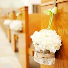 flowers in a small bag hanging down the isle