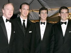 The Manning men looking fabulous! Peyton always has to stand out. LOL! But, what is really funny he does stand out and he does not have to try.