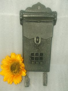 Check out this item in my Etsy shop https://www.etsy.com/listing/241854979/antique-cast-iron-mailbox-newspaper