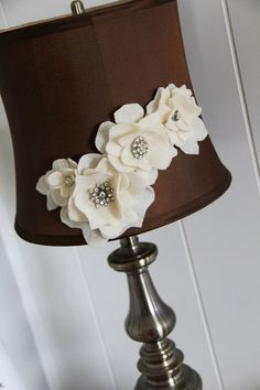 Hot glue flowers onto a lampshade to dress it up, such a cute idea!