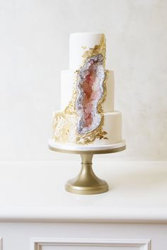 pink geode cake with edible gold foil