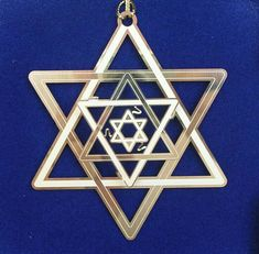 The double triangle of the Star of David (Magen David) symbolizes the connection of both dimensions of G‑d, Torah and Israel: the external level of the soul connects to the external expression of G‑d via studying the exoteric parts of Torah Jewish Jewelry, Hannukah, Jewish Art, Menorah, Star Of David, Sacred Geometry, Wiccan, Stars, Main Character