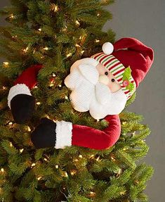 Top off your tree with this Holiday Tree Hugger. Classic Christmas character rests atop the tree and wraps his exaggerated arms around it. The arms are bendable