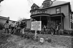 """""""This bomb crater was dug by Rainbow People of Ann Arbor on July 4, 1972. It symbolizes the death and destruction caused by U.S. bombs to the people of Indochina.""""  Peter Andrews, Kathy Kelley, Lawrence (Pun) Plamondon, David S. Fenton, David Sinclair and other members of the Rainbow People's Party and the commune at 1510 Hill St fill in the bomb crater they had dug nearly 3 years earlier in the front lawn, May 1975 — in Ann Arbor Michigan.  Photo credit: Herald Company, Inc. David Sinclair, Ann Arbor, Vietnam War, Destruction, Photo Credit, Michigan, Nostalgia, United States, Street View"""