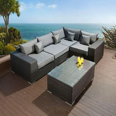 Luxury outdoor garden 5 PC sofa set/settee black rattan/grey cushions 2. Made from fully weatherproof PE rattan, hand woven over a rust resistant frame. This maintenance free set is designed to be left outside all year round without the need for covering (cushions should be stored indoors during wet weather) . The frame is made from 1.2mm thick aluminium tube with grey powder coating applied after welding. Call 02476 642139 or email sales@quatropi.com for additional information.