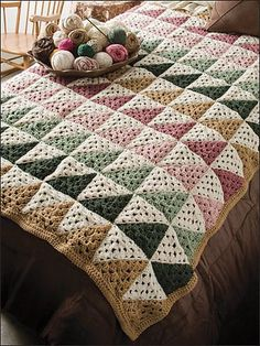 Quilt-style afghan made with half-granny squares. Lots of potential quilt-style patterns using this method. But rather than paying for this specific pattern, here's a *free* one for the half-granny square.: