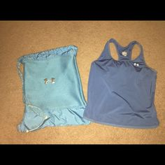 """Under Armour Bundle Two items for the price of one! Like new Under Armour bag and size large work out too. Bag is light blue with design and """"protect this house"""" written on the bottom. Top is a steel blue with built in sports bra. Top does run a little snug. No flaws! Under Armour Tops"""