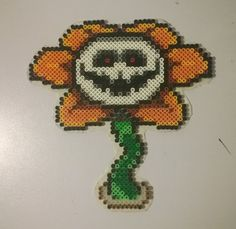 You're best friend.... #diy #perlerbeads #perlerbeadart #perlerbeadsprites #undertale #tobyfox #undertale_sprites #flowey #floweytheflower #yourbestfriend #killorbekilled