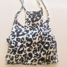   H&M   Leopard Top Leopard Divided by H&M top. Tag says size 12, fits like a M/L in my opinion. Thanks for looking! Divided Tops