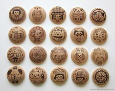 Wood-burned doodles onto buttons.  This gal has an amazing website of doodley art.