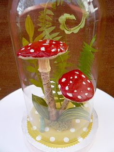 Katie Runnels 2009 Mixed media mache mushrooms, fern fronds and leaves, paper, chipboard base construction, glass dome. Collection of Elizabeth Demos
