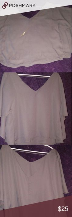 Open back top This is a flowy top with an open back. The hem is curved. The color is a slate type of gray. BKE Red lable Tops Blouses