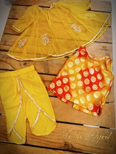 Yellow net panelled dress with Brocade underlay and wrap pants. Call/ whatsapp us on Girls Dresses Sewing, Sewing Kids Clothes, Dresses Kids Girl, Kids Outfits Girls, Kids Party Wear Dresses, Kids Dress Wear, Kids Gown, Dress Party, Kids Frocks Design