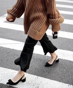 {Sweater and block heels.}