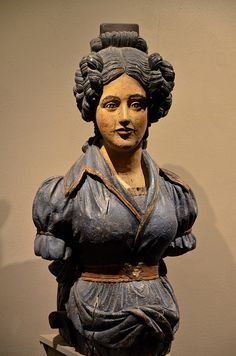 Woman with a comb figurehead (masthead) at Mystic Seaport, Connecticut