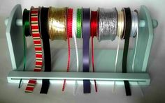 Spool Ribbon Sorter - great if you only have 10 spools of ribbon.  I have maybe 200!!! Might try just for Christmas ribbon!