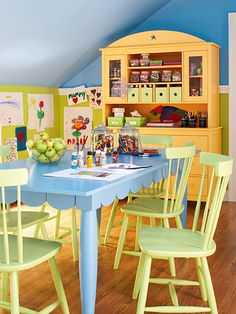 A Colorful Playroom Makeover ~ choose this generous table for its versatility -- it's the perfect surface for craft projects, family game night, or having snacks with friends after school. The bright hutch added a pop of color and plenty of storage in this play space. Maybe incorporate hutch & table in keeping room...
