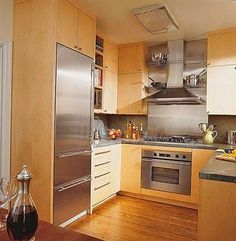 metallic back splash blonde wood kitchen cabinets lots of chromestainless steel blonde wood office