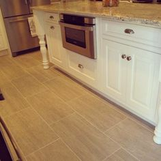 We just love the porcelain tile used in this Cumberland, Rhode Island kitchen