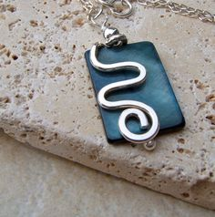 Sterling Silver Squiggle and MOP Shell Pendant. $30.00, via Etsy.