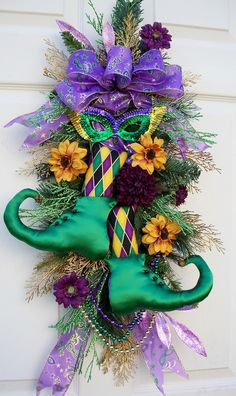 Whimsical Mardi Gras Wreath!  http://www.timelessfloralcreations.com/ https://www.facebook.com/timelesswreaths