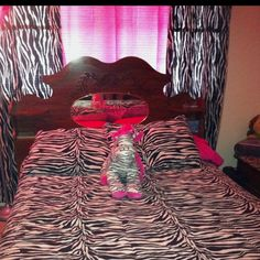 Zebras! Fun curtains and bedding, but the headboard really clashes.
