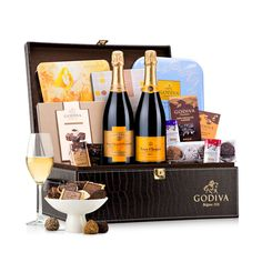 Two full sized bottles of Veuve Clicquot Champagne and a treasure of Godiva's most beautiful chocolate gift boxes make this a luxury gift set to remember.