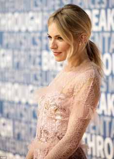 Effortless: Sporting such a busy dress, the American Sniper star kept the rest of her look...
