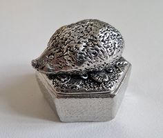 Hedgehog Hexagonal Pewter Trinket / Pill Box - Hand Made in Cornwall 1000 Flags http://www.amazon.co.uk/dp/B00YYBKE0M/ref=cm_sw_r_pi_dp_LOgKwb1H7FWAE