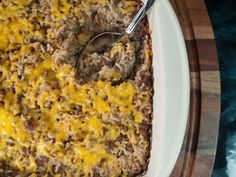 An easy family favorite. Ground beef is mixed with onion soup mix, cream of mushroom soup, onion, and rice and baked in a casserole dish until done.