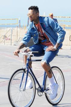 Chris Brown wearing  Nike Air Force 1 Mid '07 Sneakers, Pure Fix Cycles November Bicycle, Audemars Piguet Royal Oak Quartz, Nike Dri-Fit Cushioned Crew Socks, Club 75 The Simpsons Embroidered Denim Jacket