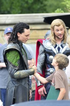 """Tom Hiddleston (Loki) greeting Mark Ruffalo's son. Ruffalo's son would come often to the set just to see Tom, saying """"That was fantastic"""" after the cameras rolled. Hiddleston's response was """"I'm doing this for you,"""" later explaining that Mark's son made him realize how powerful these films really are, especially for kids."""