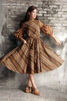Batik Amarillis made in Indonesia Batik Amarillis's Ildiko dress ...this 70ies inspired dress oozing romanticism with this full circle skirt,beautiful puff sleeves , unique belt and each details lends the style an ethereal charm.
