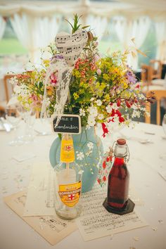 Lucy G Photography - A marquee wedding with a lace gown and colour pop theme with mix and match centrepieces.