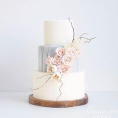 marble and sugar flower cake