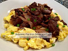 BALSAMIC FLAT IRON STEAK AND EGGS This recipe was created as a result of using leftovers.  I had left over steak from a steak salad and I thought I might try pairing it with eggs.  While the idea of balsamic vinegar and eggs didn't quite sound appealing, the dish turned out amazing.   INGREDIENTS 1½...