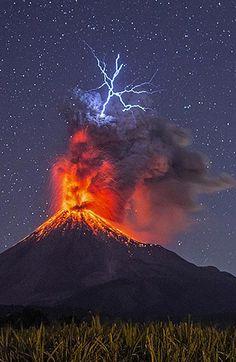 An awesome photo by Hernando Rivera, who captured this bolt of volcanic lightning. Volcanic lightning results from the frictional charging as particles of ash from the cloud collide with one another. Amazing Photography, Landscape Photography, Nature Photography, Time Photography, Volcano Pictures, Volcan Eruption, Erupting Volcano, Image Nature, Wild Nature