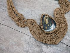 This necklace is handmade crochet by AmorArt with bronze thread and set with Tiger Iron gemstone.