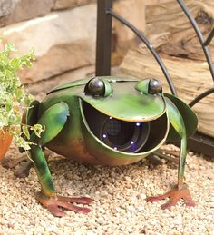 This is not only cute, it's incredibly functional!!! Perfect for those crazy spring mosquitos! (Recycled Metal Frog Sculpture With Fly And Mosquito Trap)